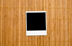 Blank photo frame on bamboo Stock Images