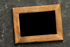 Blank photo frame on black concrete background royalty free stock image