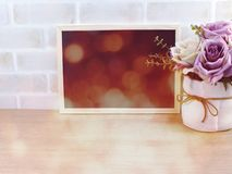 Blank photo frame with bokeh filter color background. Photo frame with bokeh filter color background royalty free stock image