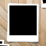 Blank photo frame on brown wood plank Royalty Free Stock Image
