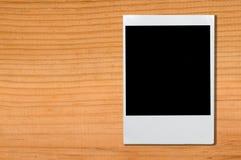 Polaroid on wood. Background Stock Photo