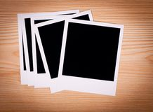 Blank photo frame on brown wooden background Stock Photography