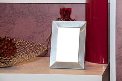 Blank photo frame on the chest of drawers Royalty Free Stock Images