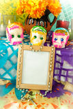 Blank photo frame on a day of the dead altar (Dia de Muertos). Traditional mexican day of the dead altar with blank photo frame, sugar skulls and candles Royalty Free Stock Photo