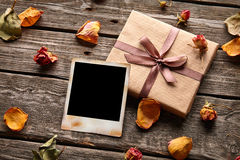 Blank photo frame with gift box Royalty Free Stock Photo