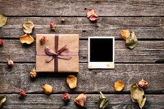 Blank photo frame with gift box Stock Photos
