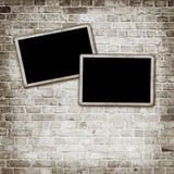 Blank photo frame on grunge wall Royalty Free Stock Photos