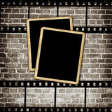 Blank photo frame on grunge wall Stock Photography