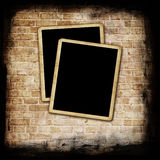 Blank photo frame on grunge wall Royalty Free Stock Images
