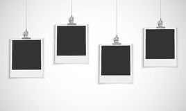 Blank photo frame hanging on a line with bulldog clip Royalty Free Stock Images