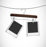Blank photo frame hanging on a rope with clothes hanger Stock Image