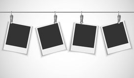 Blank photo frame hanging on a wire rope with metallic clip Royalty Free Stock Photo