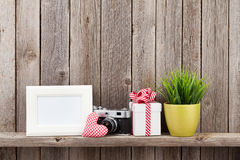 Blank photo frame, heart, camera and plant Stock Images