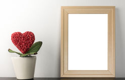 Blank photo frame with heart flower pot for romantic lover married photography. Blank photo frame with heart flower pot for romantic lover married couple Royalty Free Stock Photography
