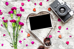 Blank photo frame in heart shaped film with retro camera and carnation flowers royalty free stock image