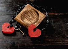 Blank photo frame, key and heart shape on wooden table Stock Image
