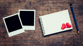 Blank photo frame, notebook, pencil and red heart for valentine Stock Images