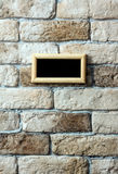 Photo frame on brick wall Stock Photography