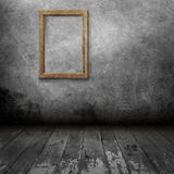 Blank photo frame on old wall Stock Image