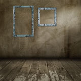 Blank photo frame on old wall Royalty Free Stock Image