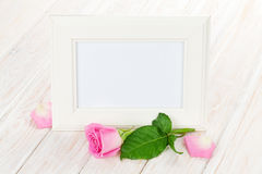 Blank photo frame and pink rose Royalty Free Stock Images