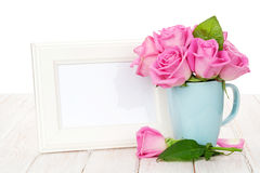 Blank photo frame and pink roses bouquet in tea cup Royalty Free Stock Photography