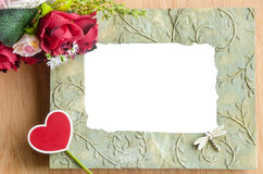 Blank photo frame and red rose. Royalty Free Stock Photos