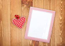 Blank photo frame and red Valentine's day heart toy Stock Image