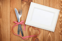 Blank photo frame and silverware Stock Images