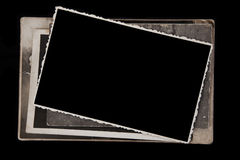 Blank photo frame on a stack of old photos. Royalty Free Stock Images