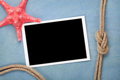 Blank photo frame with starfish and ship rope Stock Image