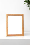 Blank photo frame on table in the room Stock Image
