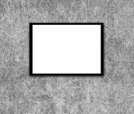 Blank photo frame on wall Stock Image