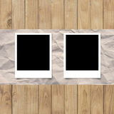 Blank photo frame on White paper on wood planks texture backgrou Stock Image