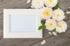 Blank photo frame and white roses Stock Photos