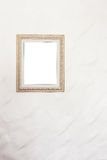Blank photo frame on white wall Stock Images