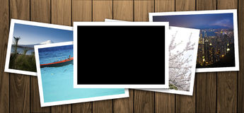 Blank photo frame on wood texture background Royalty Free Stock Photos