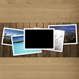 Blank photo frame on wood texture background Stock Image