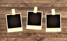 Blank Photo frame on wooden background Stock Photography