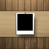Blank photo frame on wooden texture background Royalty Free Stock Photography