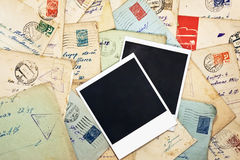 Blank photo frames. On wallpaper background with old envelopes Stock Photography