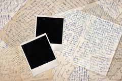 Blank photo frames. On wallpaper background with old letters Royalty Free Stock Photo