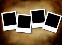 Blank photo frames. On aged background Stock Photo