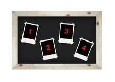 Blank photo frames on blackboard isolated Stock Photography