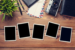 Blank photo frames, camera and supplies Stock Images