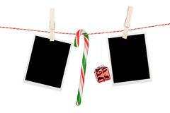 Blank photo frames and candy cane hanging on the clothesline Royalty Free Stock Image