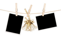 Blank photo frames and christmas decor hanging on the clothesline