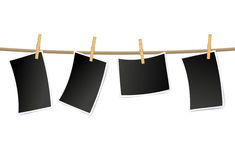 Blank photo frames on a clothesline Royalty Free Stock Image