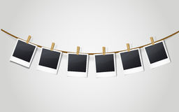 Blank photo frames on a clothesline Stock Images