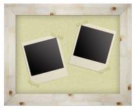 Blank photo frames on cork board Royalty Free Stock Photos